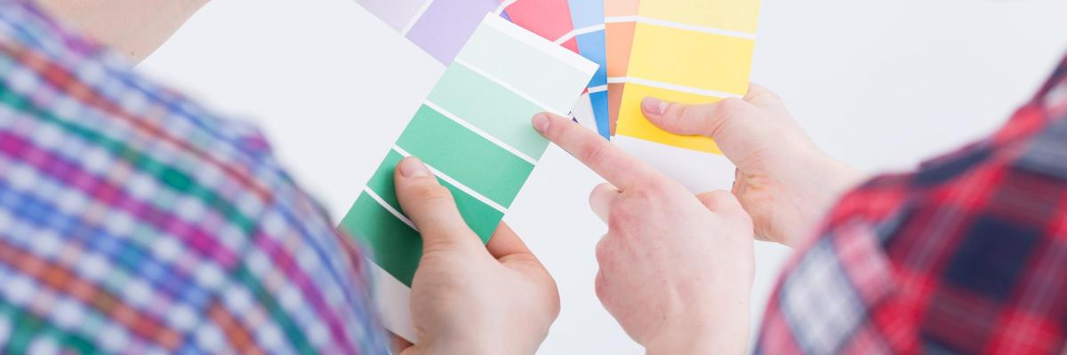 people choosing paint colours for painting house