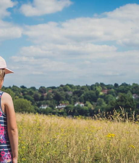 girl looking at surrey county landscape